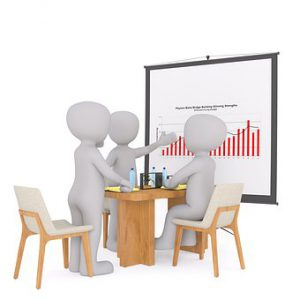 annual review setting, 3 people sitting at table with chart
